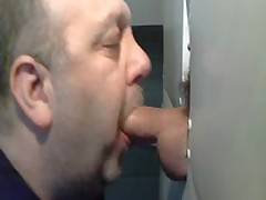 BEAR SUCKING BIG COCK AT GLORYHOLE