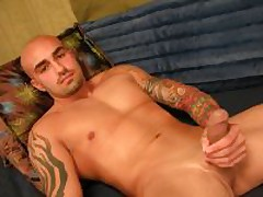 Uncut Tattooed Muscle Stud Stroking His Massive...