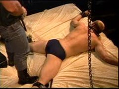 Stomping A Muscular Dudes Balls While He Is Restrained Face Down.