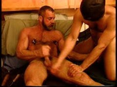 Hairy Bodybuilder Gets His Balls Bashed And Squeezed By Leather Masked Buddy As Both Jack Off.