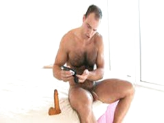 Hairy Muscle Guy Stuffs Dildo Up His Ass
