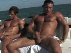 Muscle Guy And Cute Friend Jerking Off On Boat