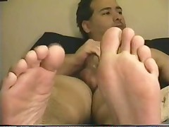 Jerkoff In Bed Showing Feet