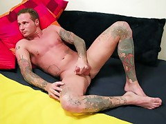 Muscled Tatted Hunk Jerks Off